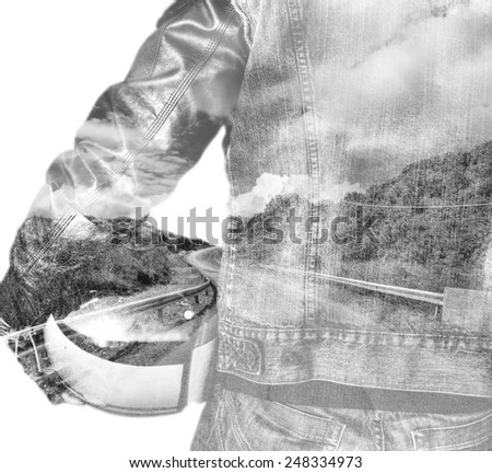 double exposure of a biker and winding road in black and white - stock photo