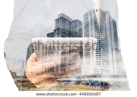 Double exposure of a businessman and a city using a tablet over white background as Business Technology Concept - stock photo