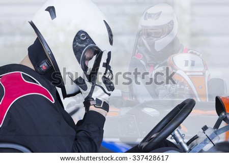 double exposure of a profile view of a concentrated karting pilot sitting on his go-kart before starting a race in an outdoor go karting circuit - focus on the eye - stock photo