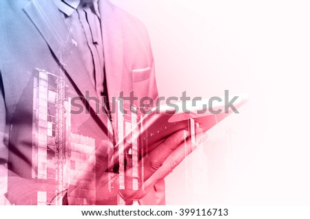 Double exposure of Architect or Business Man use Mobile Tablet with Construction Site - stock photo