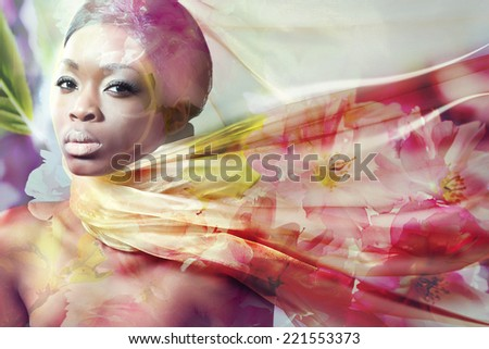 Double exposure of beautiful young woman wearing silk scarf and sakura flowers - stock photo