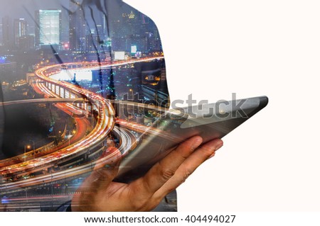 Double exposure of Business Man use Mobile Tablet with Urban City Scenic and HighWay as High Speed Internet or Wireless TeleCommunication  - stock photo