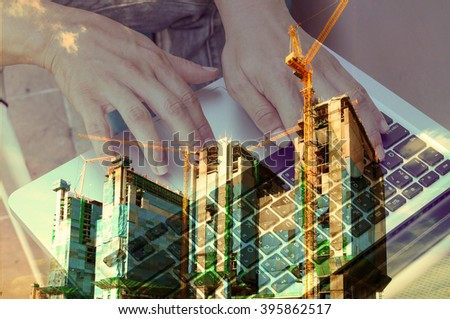 Double exposure of Business Man use Notebook with Construction site and Power Crane for use as Background in Modern Real Estate development concept. Vintage Tone Color Effect used in this image.  - stock photo
