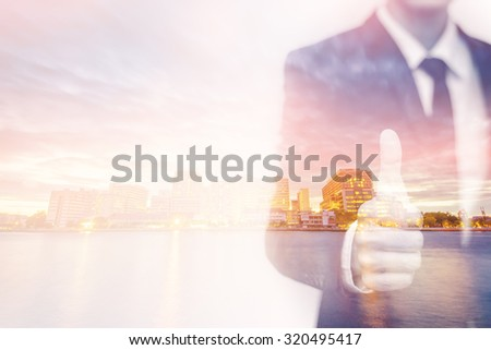 Double exposure of businessman and city - stock photo