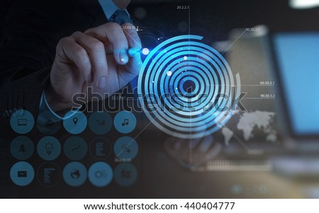double exposure of businessman hand drawing virtual chart business on modern computer - stock photo