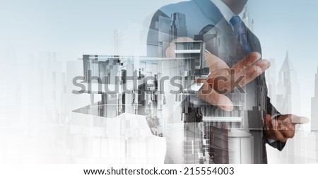 Double exposure of businessman hand presents house model on modern computer as development concept  - stock photo