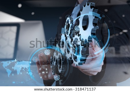 double exposure of businessman hand working with cog gear to success as concept - stock photo