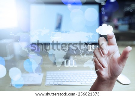 Double exposure of businessman hand working with modern technology as digital cloud concept  - stock photo