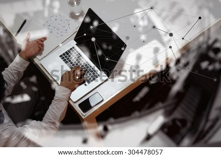 Double exposure of businessman hand working with new modern computer and business strategy as concept and social network diagram    - stock photo