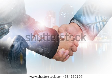Double exposure of businessman handshake on industrial business background. - stock photo