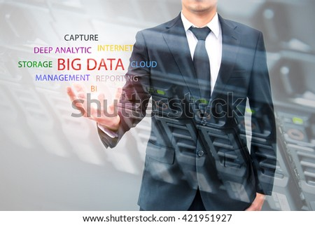 Double exposure of businessman holding big data information and server storage in data center, IT Business concept  - stock photo