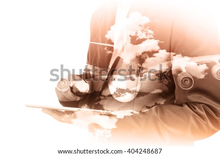 Double Exposure of Businessman use Computer Tablet with Airplane and Cloud Sky as Transportation Business Concept - stock photo