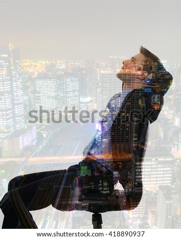Double exposure of businessman with cityscape - stock photo