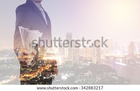 Double exposure of Businessman with money in hand  with cityscape blurred building background, US dollar (USD) bills - investment, success and profitable business concepts - stock photo