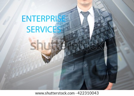 Double exposure of businessman with servers technology in data center in IT enterprise services concept - stock photo