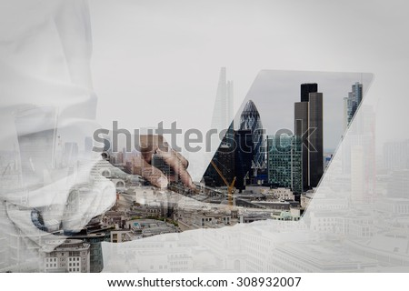 double exposure of businessman working on his laptop in office with london city background - stock photo