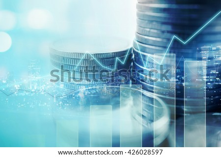 Double exposure of city and graph on rows of coins for finance and banking concept - stock photo