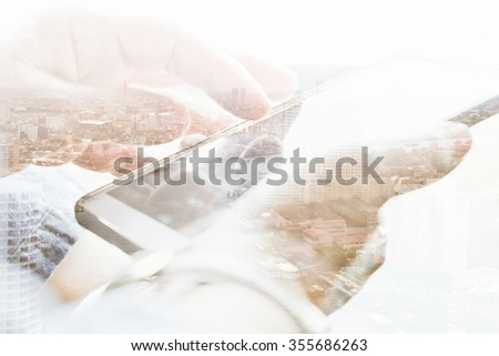 Double exposure of cityscape and smart phone, communication technology concept.  - stock photo