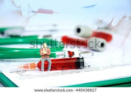 Double exposure of hand  holding test tube  and blood plasma with medical documents with little toy doctor and a green stethoscope, test tube, blood plasma and syringe on white background. - stock photo