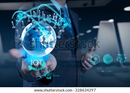 double exposure of hand showing Internet of things (IoT) word diagram as concept - stock photo