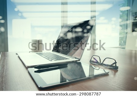 double exposure of Office workplace with laptop and smart phone on wood table with eyeglasses on digital tablet - stock photo