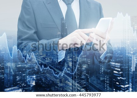 Double exposure of professional businessman connect internet smart phone and cityscape of business centre with international world financial graph, Business , finance , trading and banking concept - stock photo