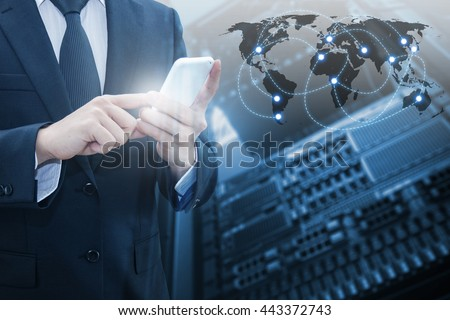 Double exposure of professional businessman connecting internet smart phone with servers technology and connect world network in IT Business concept, element of this image furnished by NASA - stock photo