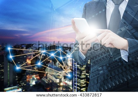 Double exposure of professional businessman using smart phone with servers technology , city center of business and world map network connection in IT Business concept, world map from NASA - stock photo