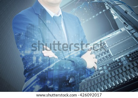 Double exposure of professional businessman with servers technology in data center and city in IT Business concept - stock photo