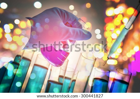 Double exposure of scientist hand holding laboratory flask. - stock photo