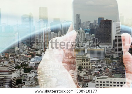 Double exposure of smart phone and cityscape background, urban lifestyle and communication technology concept.  - stock photo