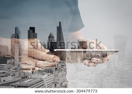 Double exposure of success businessman using digital tablet with london building and social media diagram  - stock photo