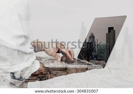 Double exposure of success businessman using laptop computer with london building and social media diagram  - stock photo