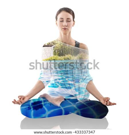 Double exposure of woman meditating - stock photo