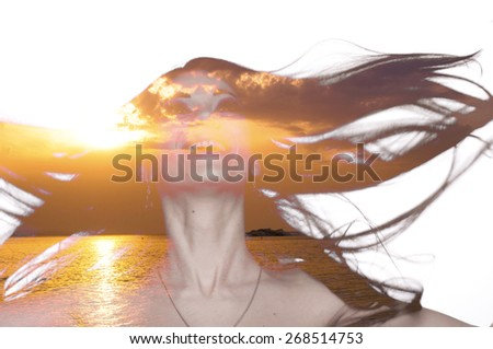 Double exposure photo of a young woman with fluttering hair and sunset over sea - stock photo