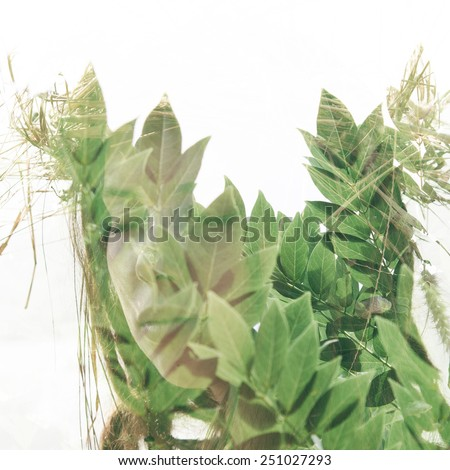 Double exposure portrait of a girl combined with photograph of greenery - stock photo