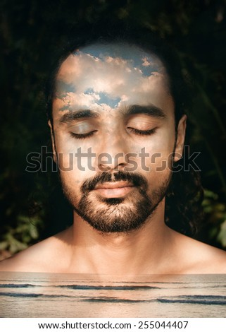 Double exposure portrait of a man combined with a photograph of a sea and clouds - stock photo
