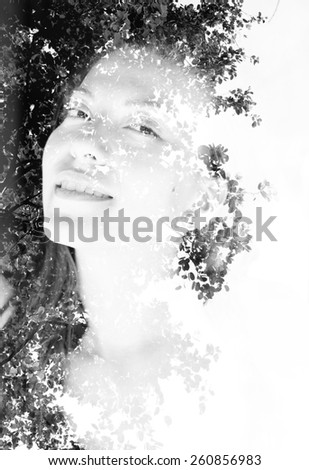 Double exposure portrait of attractive woman combined with photograph of a tree - stock photo