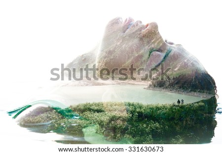 Double exposure portrait of attractive woman combined with photograph of lake surrounded by mountains - stock photo