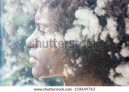 Double exposure portrait of beautiful woman combined with  photograph shot from a plane - stock photo