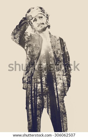 Double exposure portrait of handsome young man - stock photo