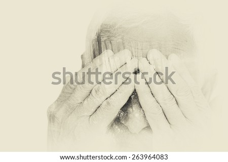 Double exposure portrait of senior man covering his face with his hands. black and white image, vintage effect  - stock photo