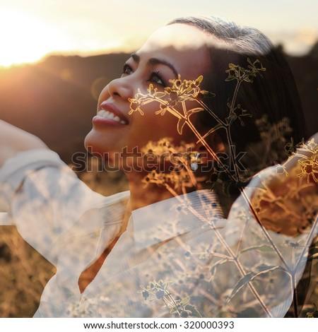 Double exposure portrait of young woman in sunset landscape. Vintage concept. - stock photo