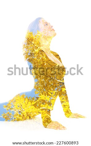 Double exposure portrait of young woman performing yoga asana - stock photo