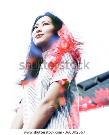 Double exposure portrait with beautiful Asian business woman and red flowers - stock photo