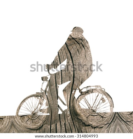 Double exposure - Silhouette of an old man who ride a bicycle and knot and rings in natural wood - stock photo