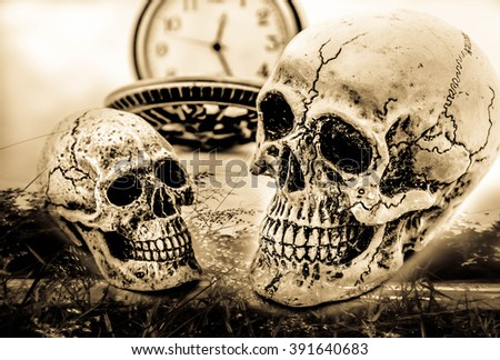 Double exposure skulls couple with vintage pocket watch ,Concept love and time ,Vintage tone - stock photo