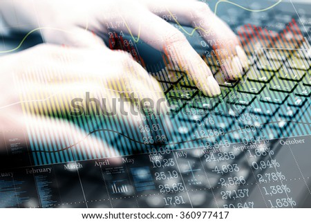 Double exposure, typing on keybord and business charts. Shallow dof. - stock photo