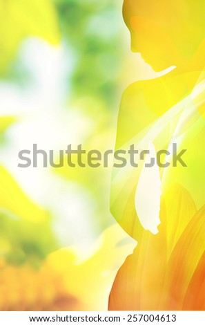 double exposure woman silhouette and spring floral colorful patterns and shapes  - stock photo