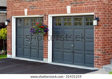 Double Garage with flower pot - stock photo